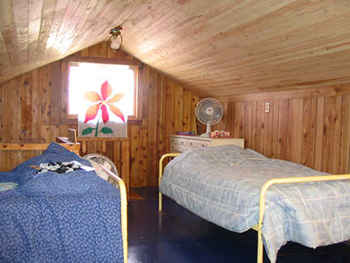 The attic holds three twin size beds