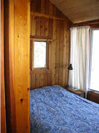 The master bedroom overlooks the lake - Queen Size Bed